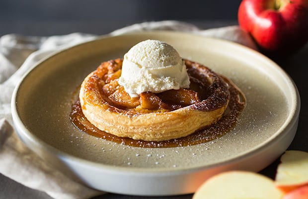 flaky puff pastry, caramelized apples, tahitian vanilla ice cream, caramel sauce.