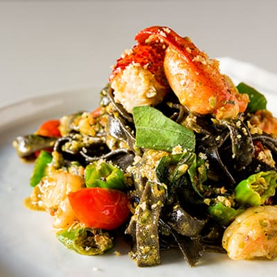 Ocean wise™ Canadian lobster and prawns, pistachio green chili pesto, squid ink tagliatelle.
